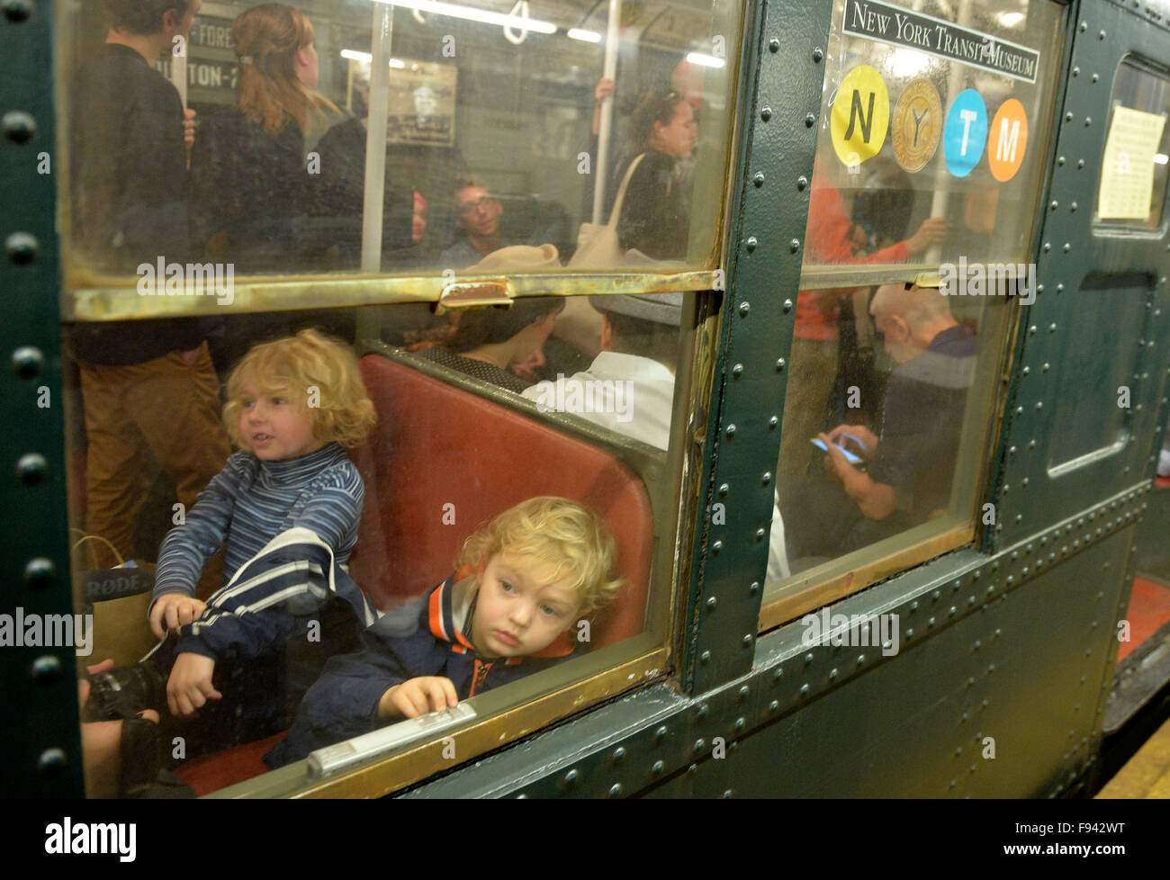 New York, USA. 13th Dec, 2015. Children experience antique cars at a subway station in New York City, the United Stock Photo