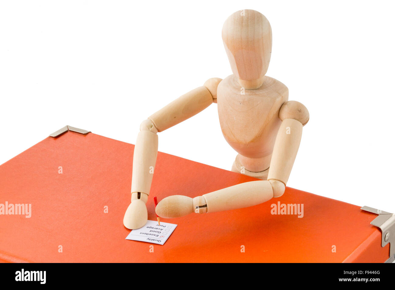 Puppet conducts quality check with checklist - Stock Image