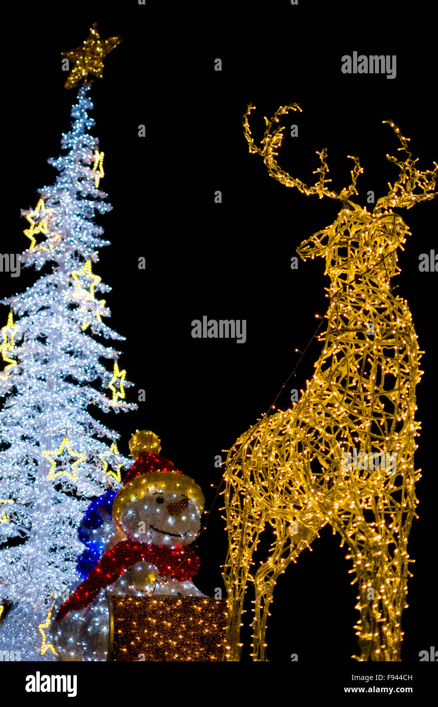 Yellow Deer With Snowman And White Christmas Tree Decoration Lights Vertical Isolated On Black Background