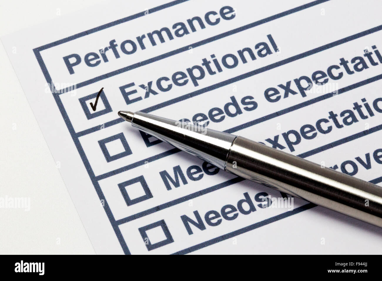 Performance evaluation paper with pen and tick marks - Stock Image