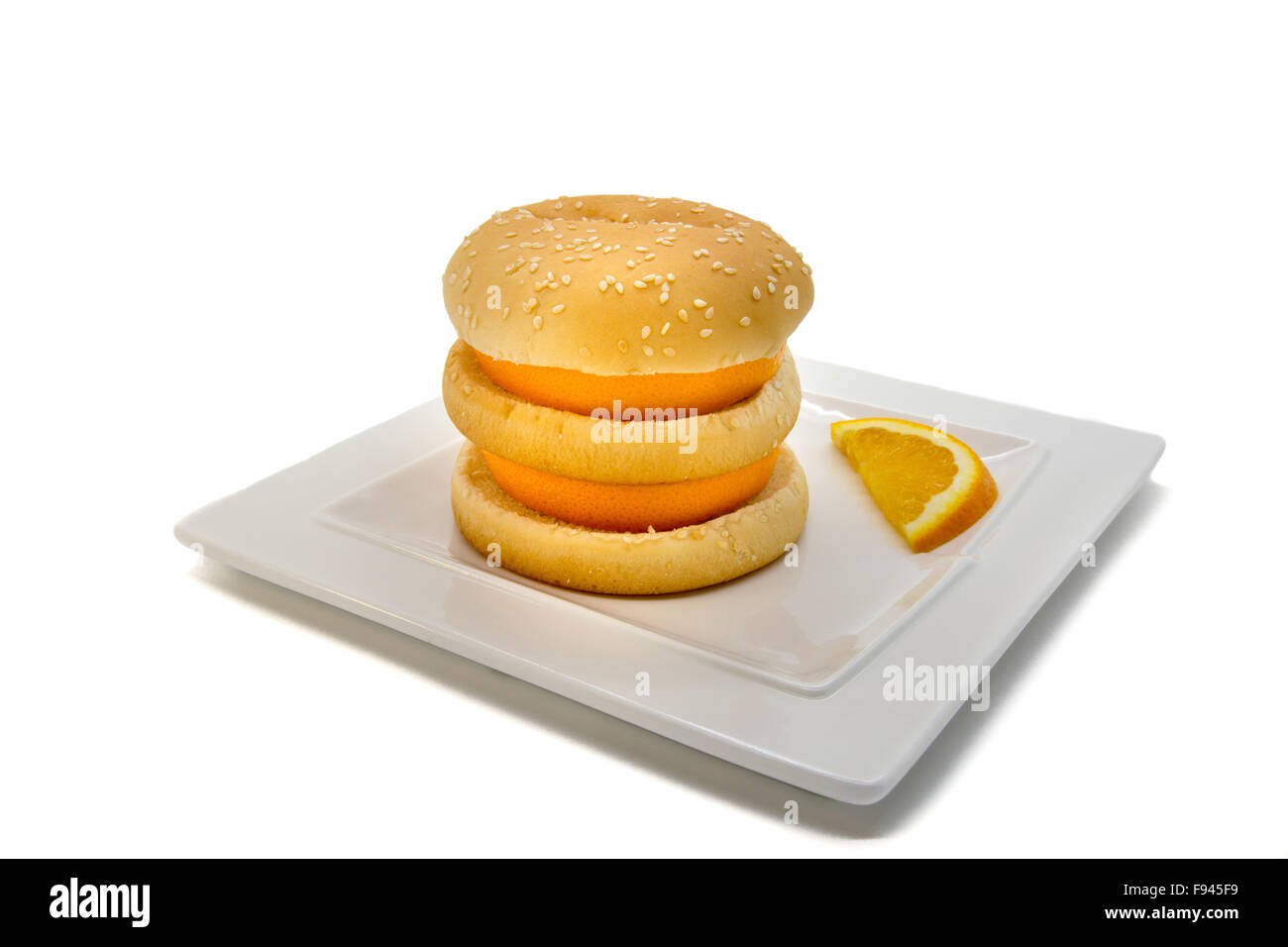 Burger with oranges on a white plate and background - Stock Image