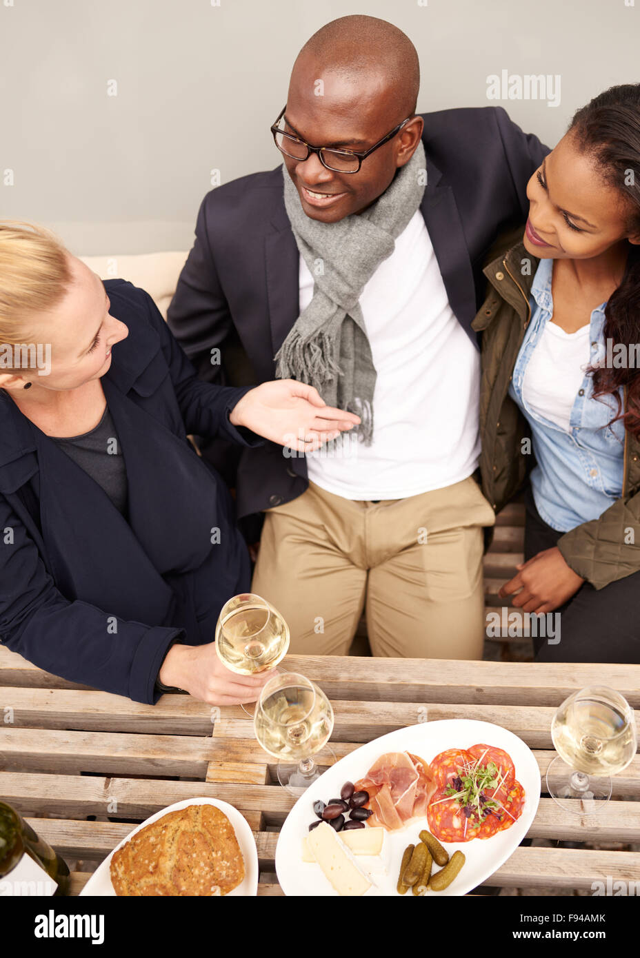Group of friends having dinner outside, multi ethnic group - Stock Image
