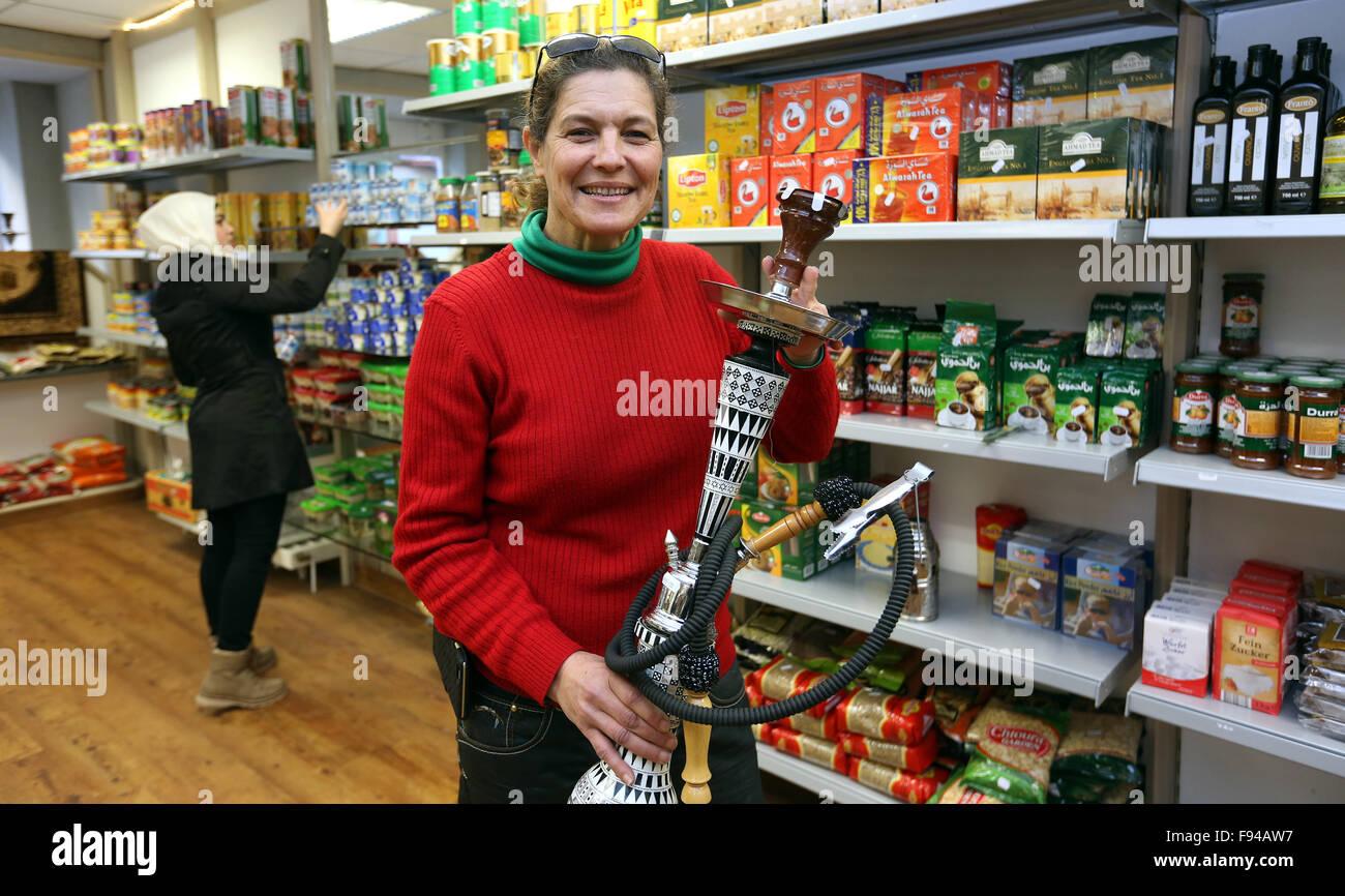 Sigmaringen, Germany. 07th Nov, 2015. Shop owner Zainab Shami poses inside her grocery shop 'Damaskus' with - Stock Image