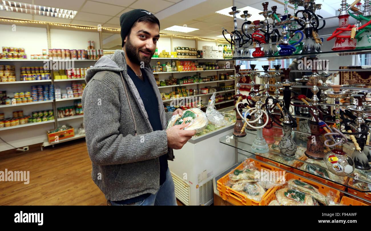 Sigmaringen, Germany. 07th Nov, 2015. Syrian asylum seeker Fandy Morshed shops inside grocery shop 'Damaskus' - Stock Image