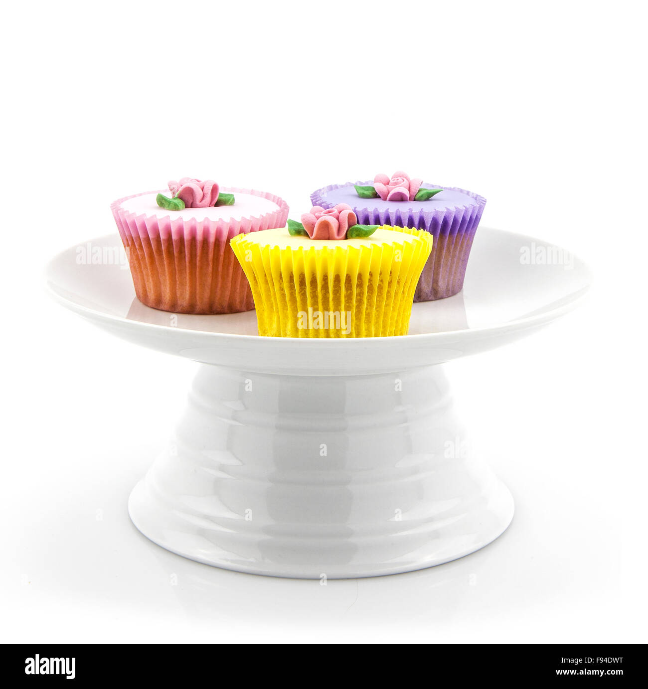 Cupcake selection on white china stand - Stock Image