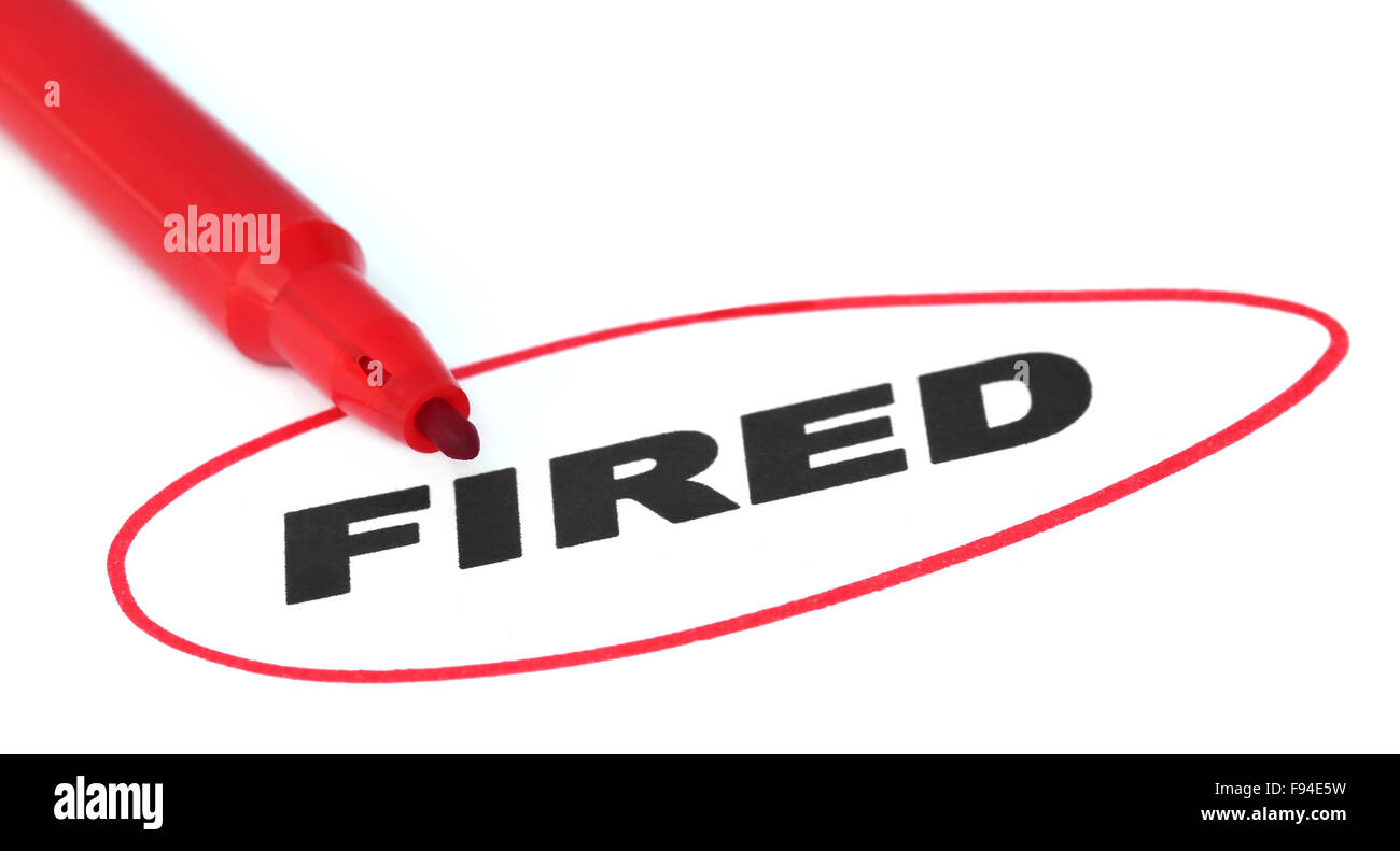 Fired written by red pen over white background - Stock Image