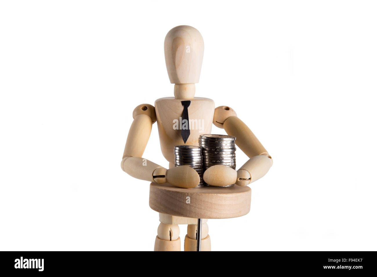 Businessman puppet grabbing money in front of white background - Stock Image