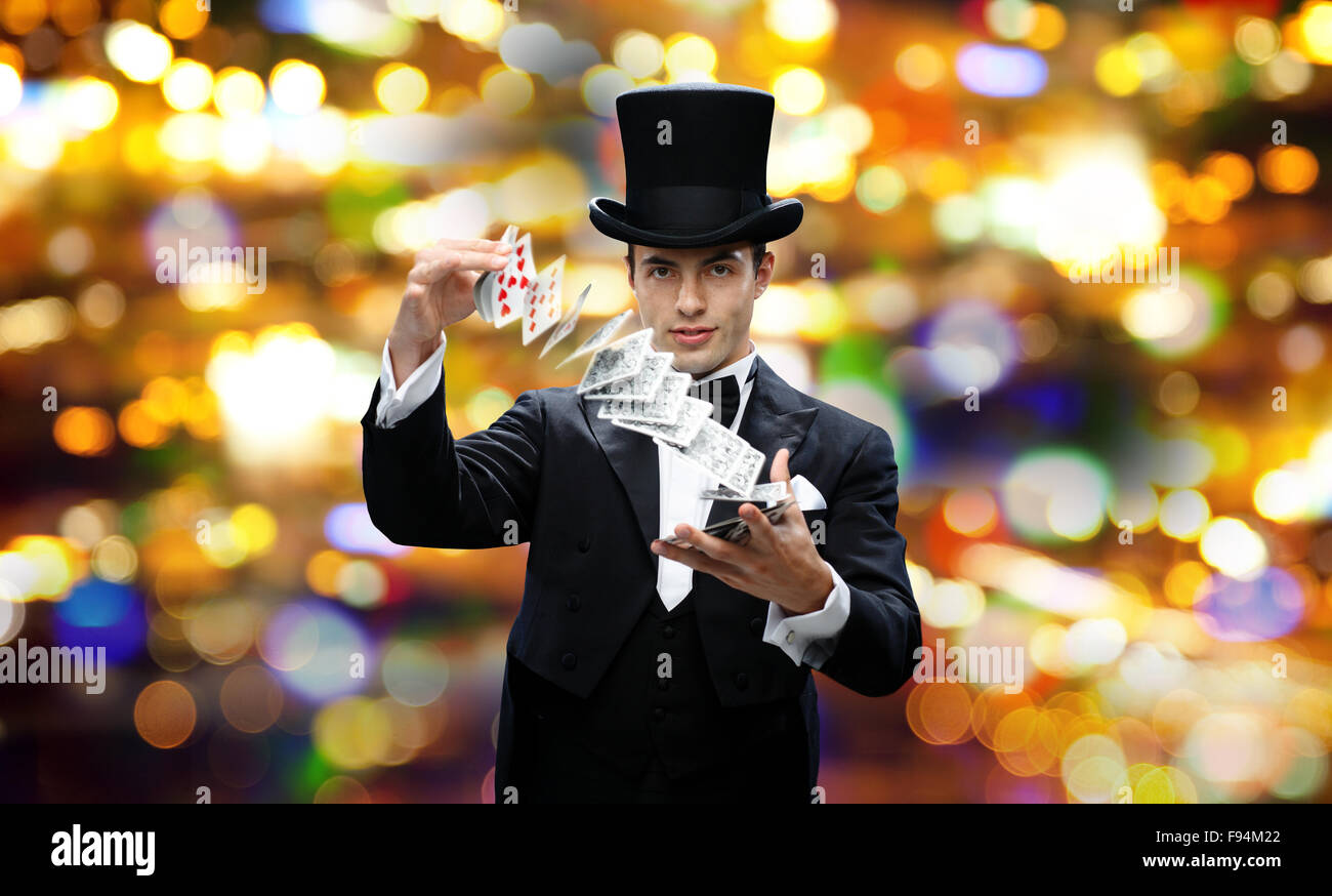 magician showing trick with playing cards Stock Photo