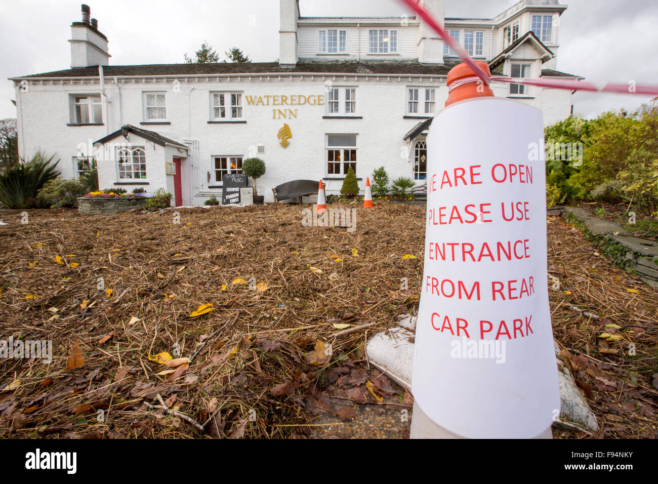 The Wateredge Inn in Ambleside, Lake District, UK, surrounded by flood debris from Lake Windermere bursting its Stock Photo