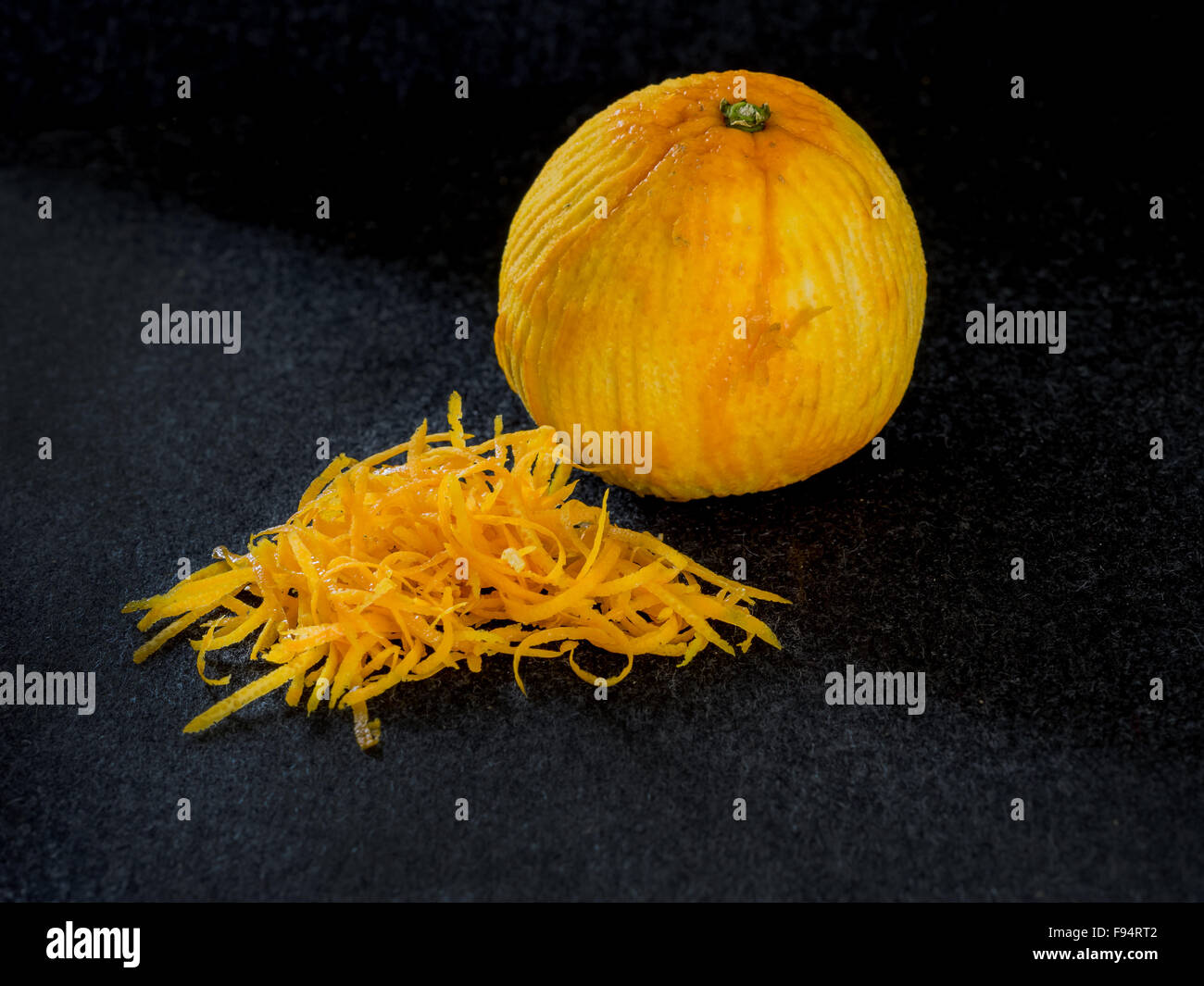 One ripe zested orange - Stock Image