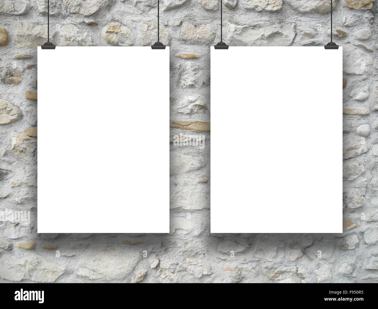 Double Hanged Paper Sheet Frames With Clips On Medieval Stone Wall