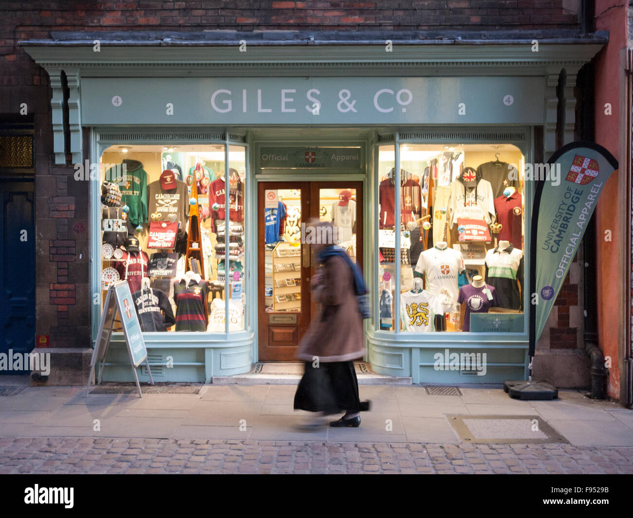The shop window at Giles and Co University of Cambridge clothing store at dusk in Cambridge UK - Stock Image