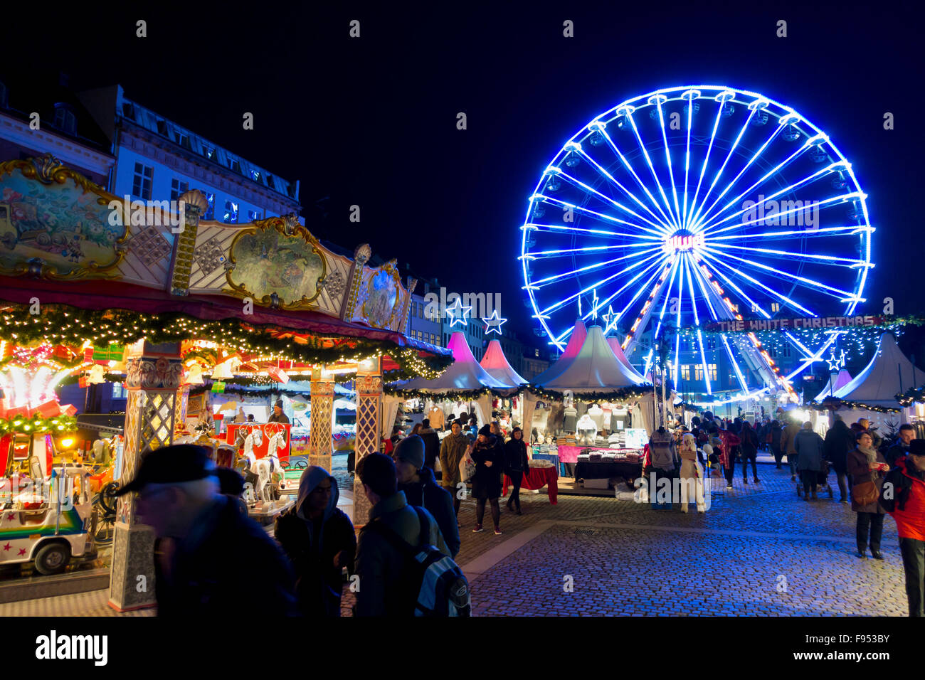 Ferris wheel, fun fair and gift and stalls at the new Christmas market in Nytorv Square at Strøget in Copenhagen, - Stock Image
