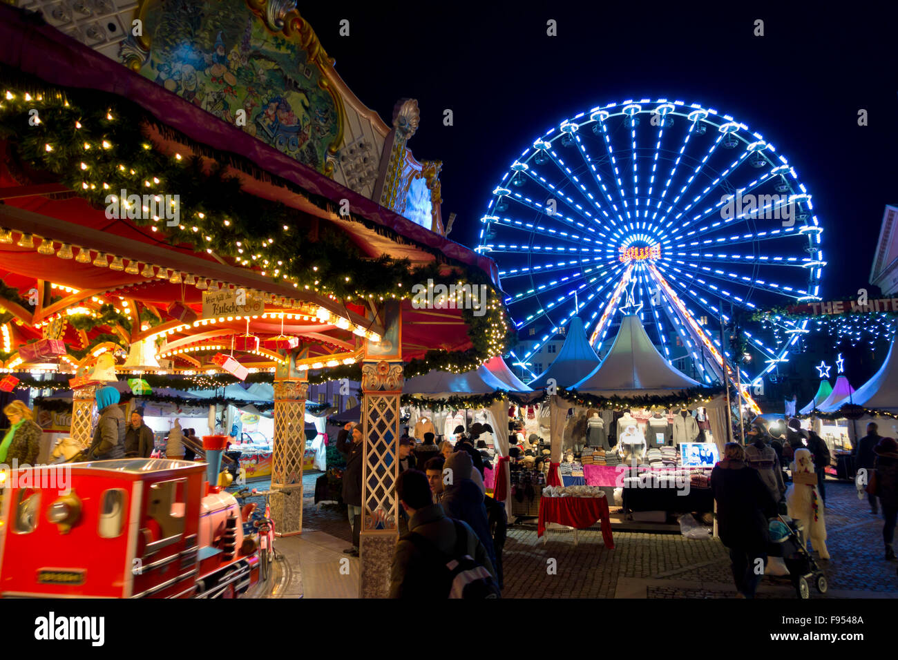Merry-go-round with Christmas train, ferris wheel, fun fair and stalls at the new Christmas market at Nytorv, Copenhagen Stock Photo