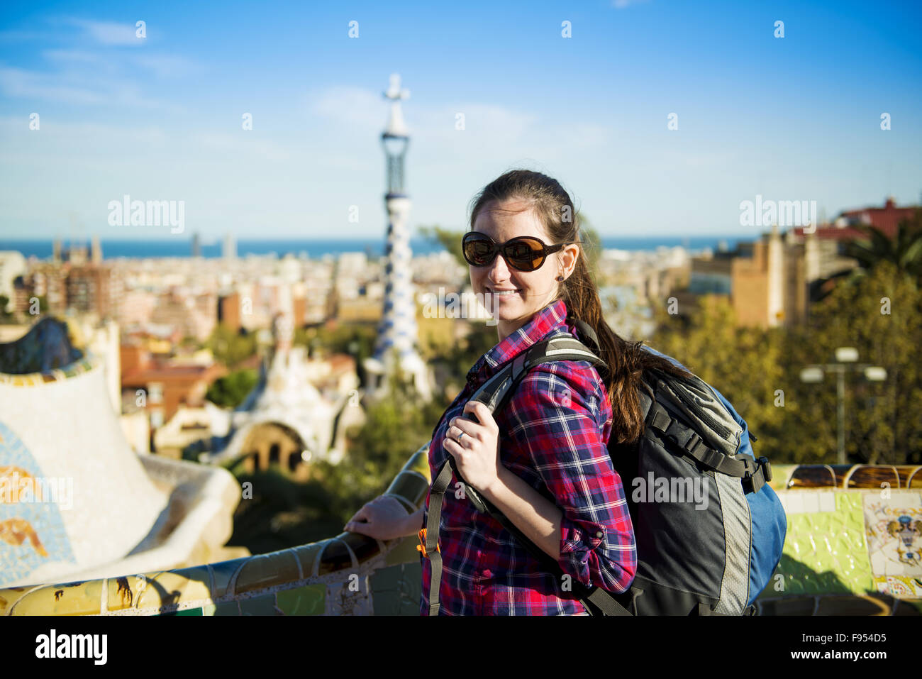 Pretty young female tourist posing in Parc Guell in Barcelona, Spain. - Stock Image