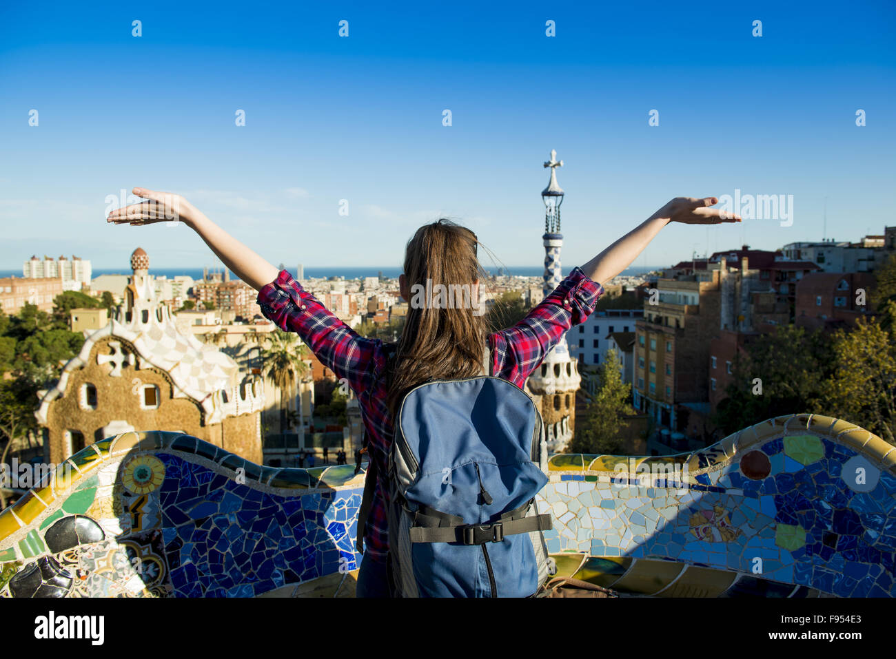 Rear view of young female tourist enjoying the view in Parc Guell in Barcelona, Spain. - Stock Image