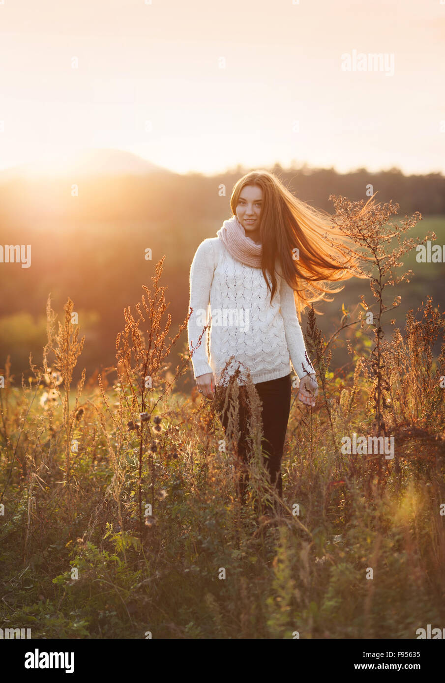 Outdoor portrait of beautiful woman in autumn meadow Stock Photo