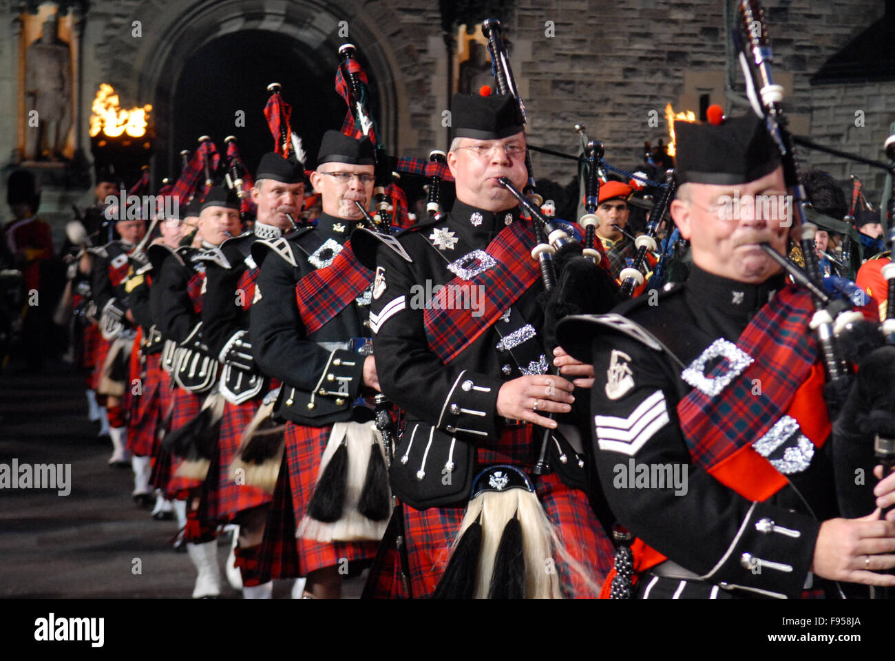 Massed pipes and drums at the 2011 Edinburgh Military Tattoo in Edinburgh, Scotland. Stock Photo