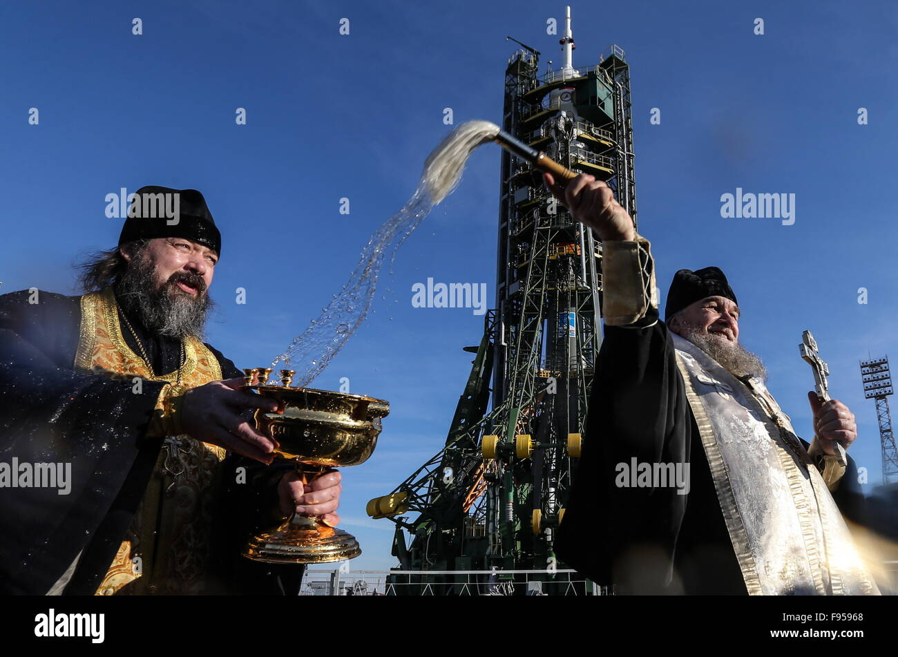 Baikonur, Kazakhstan. 14th Dec, 2015. An Orthodox priest sprays holy water on the Soyuz TMA-19M spacecraft at the - Stock Image