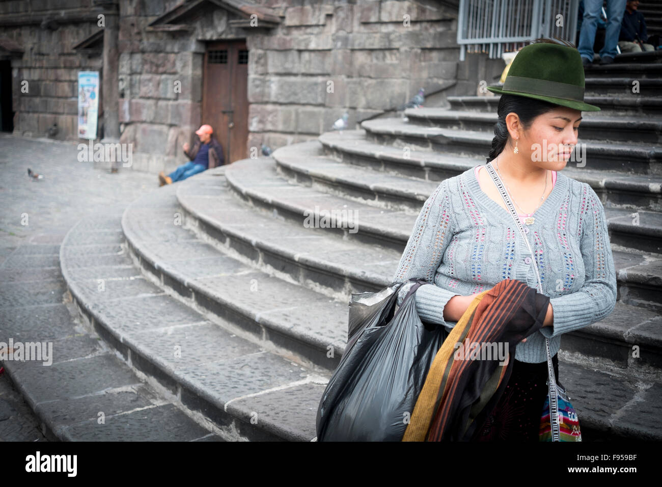 Quito , Ecuador. Plaza de San Francisco. A Woman on steps outside Iglesia San Francisco ,Plaze de San Fransisco - Stock Image