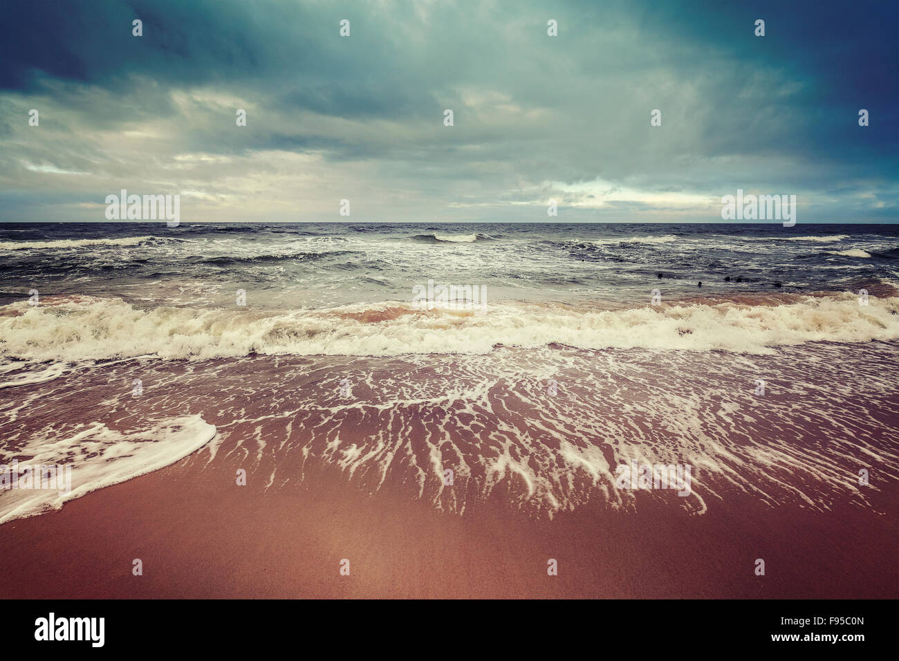 Vintage toned stormy sky over rough sea, calm before the storm concept. - Stock Image