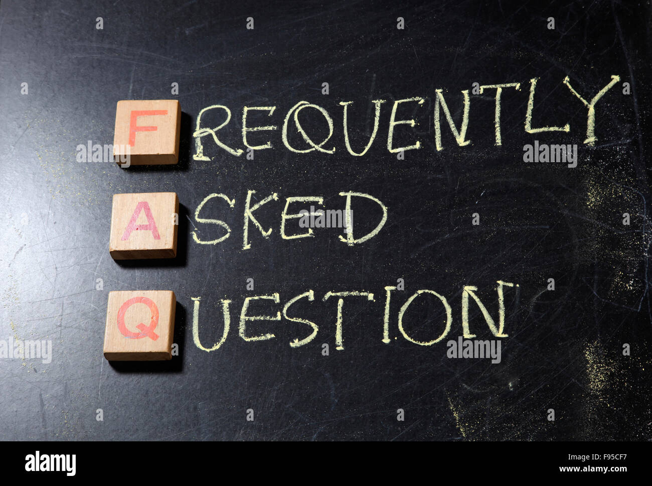 Hand writting Frequently Asked Questions (FAQ) acronym, business concept on blackboard - Stock Image