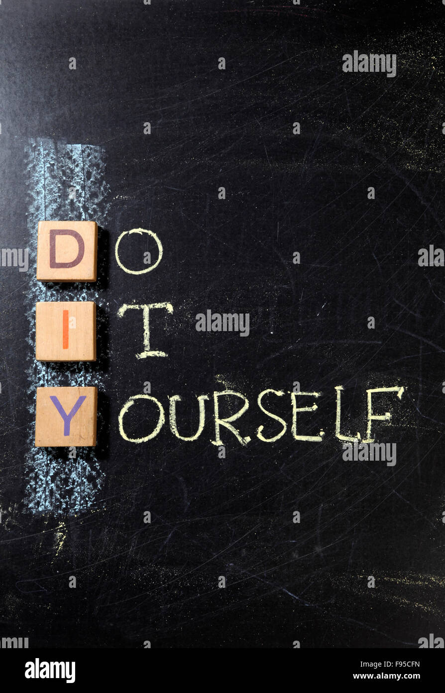 Do It Yourself (DIY), business concept acronym on blackboard - Stock Image
