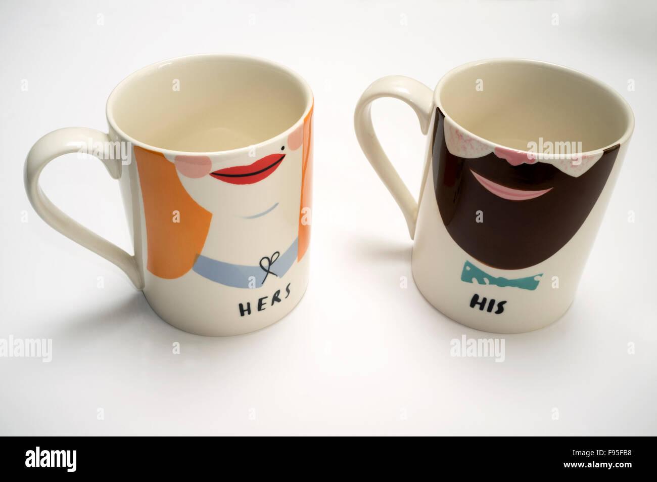 Hers & His mugs - Stock Image