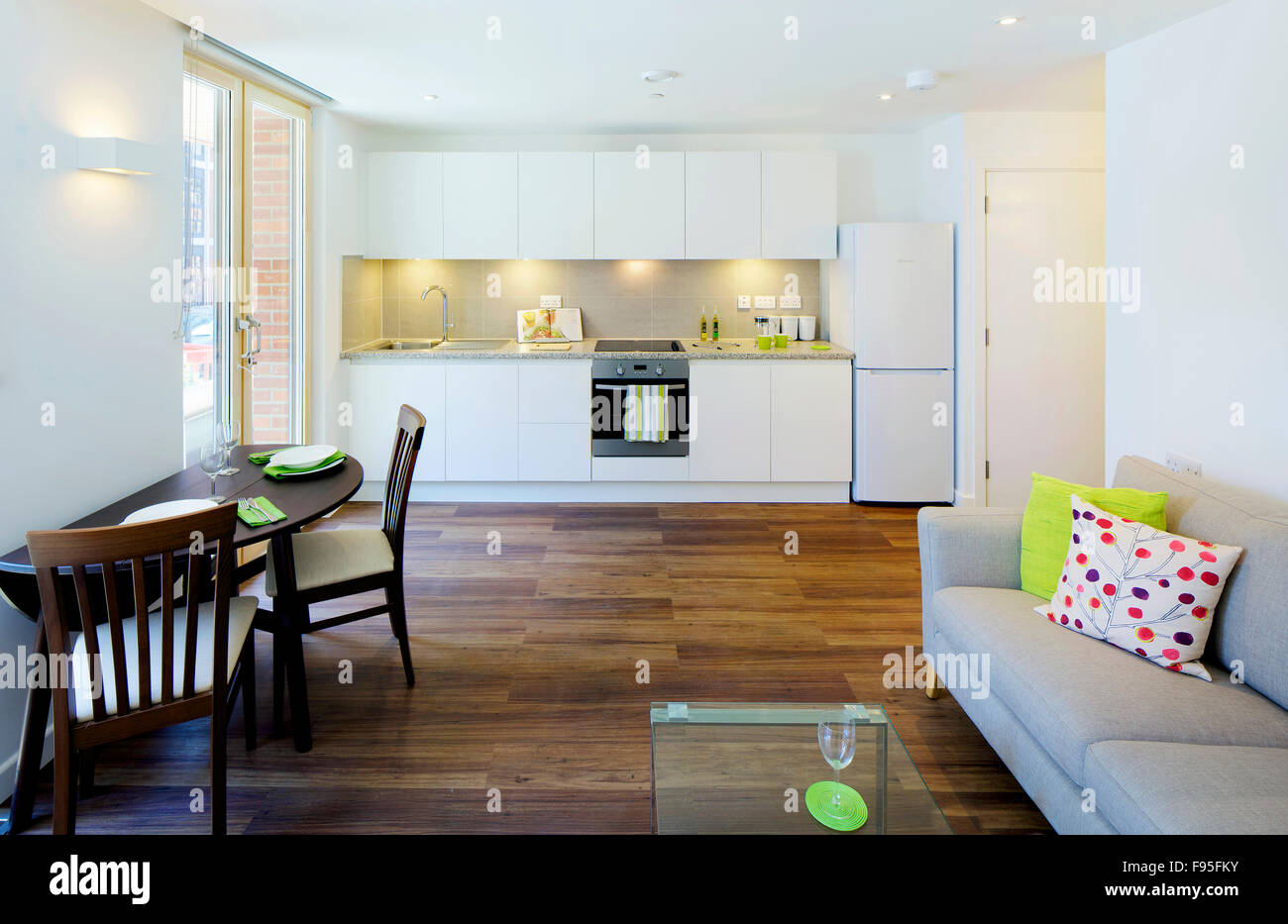 One church square london uk view of an open plan kitchen and living room modern interior white kitchen unit wood floors and furniture all in view