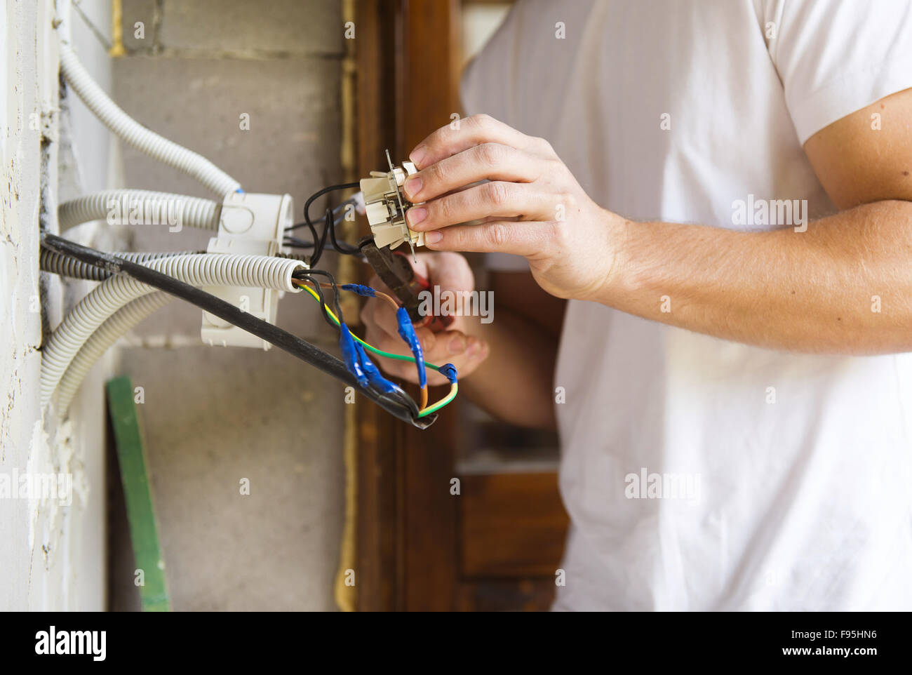 New Electrical Wiring In House Stock Photos Electrician Installing Light A Image