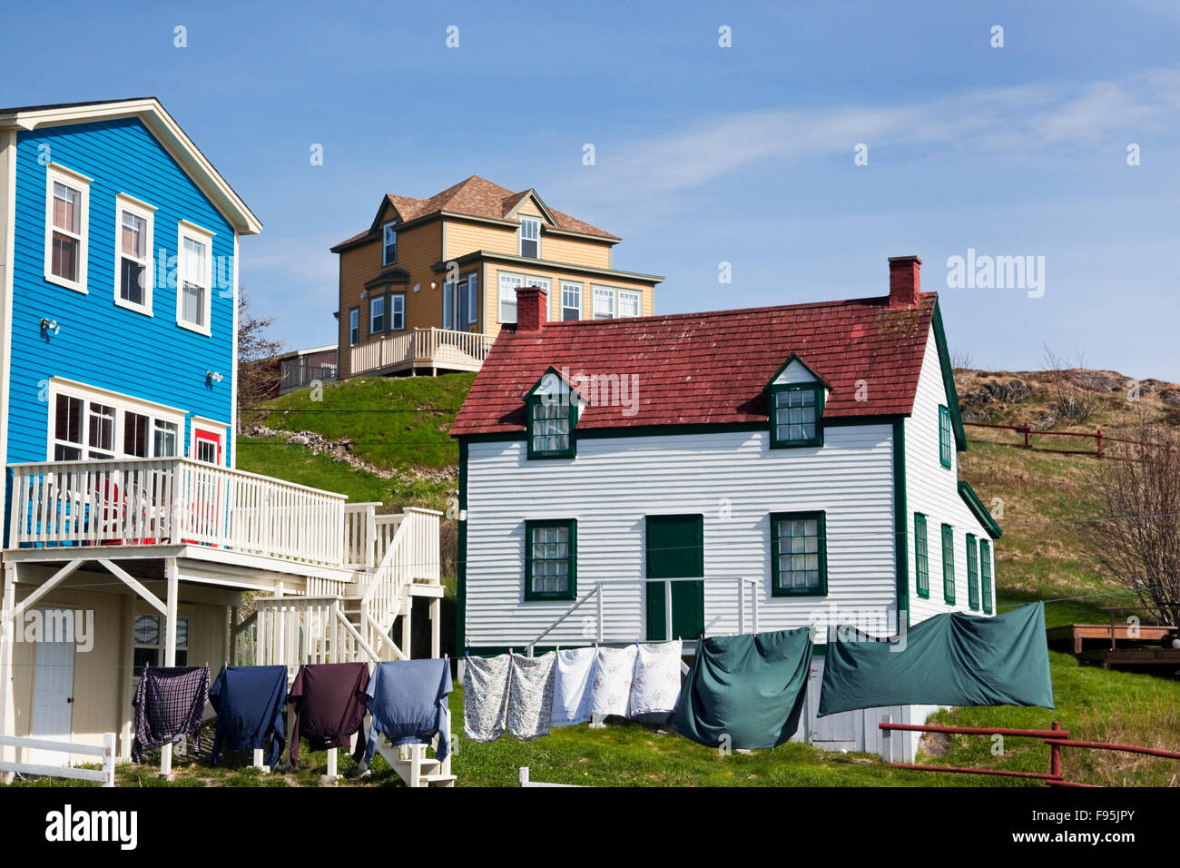 Varied colorations of houses in Trinity, Newfoundland. Many of them have a clothes line that their occupants prefered Stock Photo