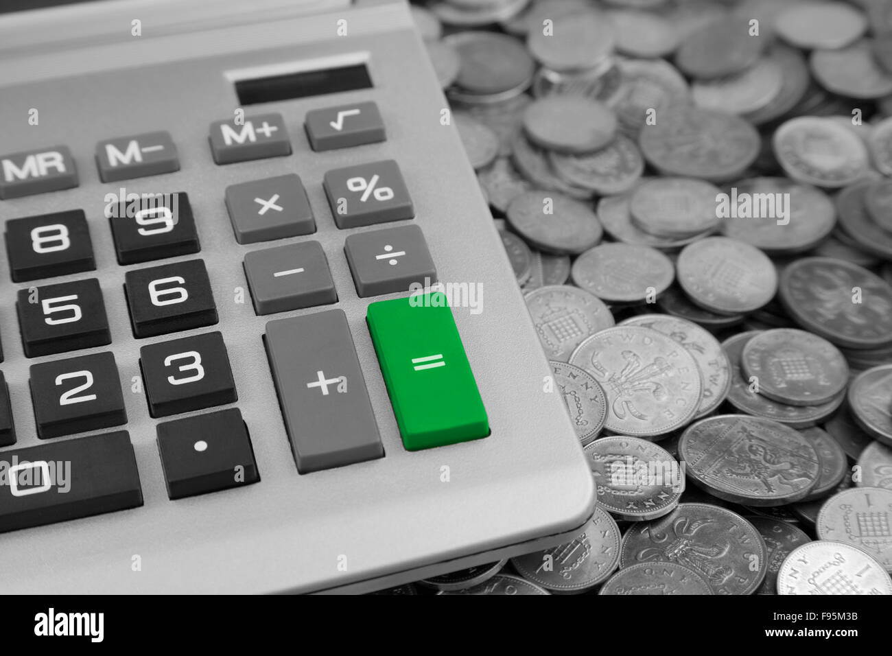 a desk Calculator with a green Equals button and Bank of england Stock Photo