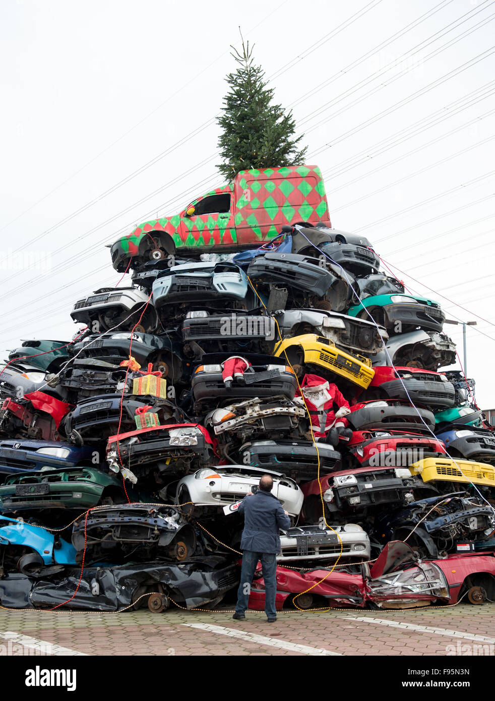 Employees at a car junkyard have decorated a pile of dozens of junk ...
