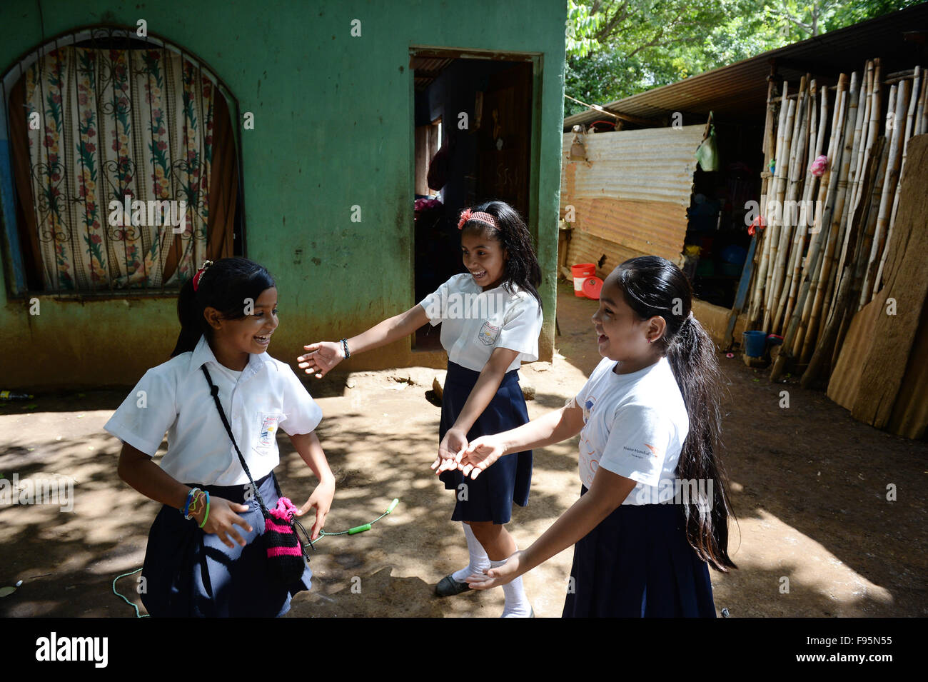 Schoolchildren play in their school uniforms between houses and huts in their village of San Francisco in the municipality Stock Photo