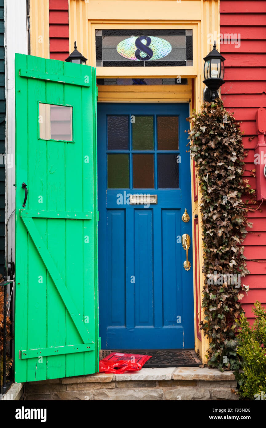 Multicoloured entrance to a Jellybean House, a term that appeared after the residents of St. John's responded - Stock Image