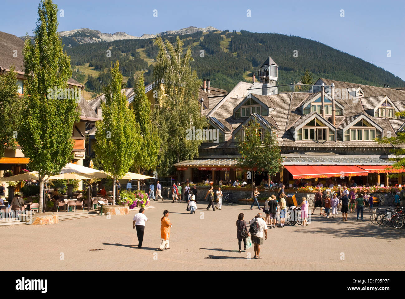 Visitors and residents wander the pedestrianonly Village Stroll in Whistler, BC during the summer - Stock Image