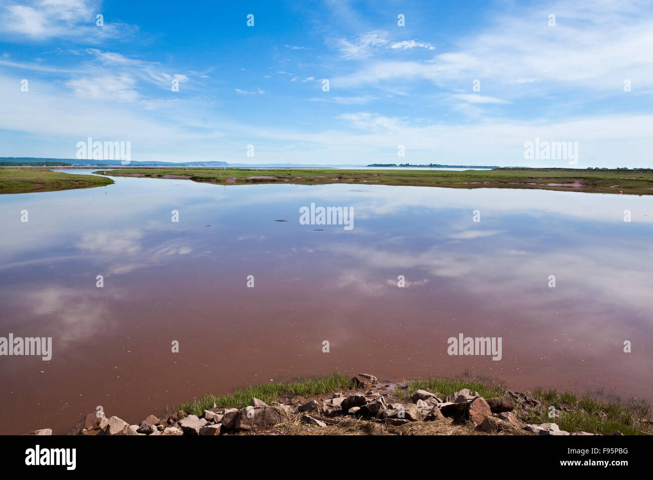 View of mudflats after they are inundated by the rising tide at the Wolfville Waterfront Park. The town is located - Stock Image