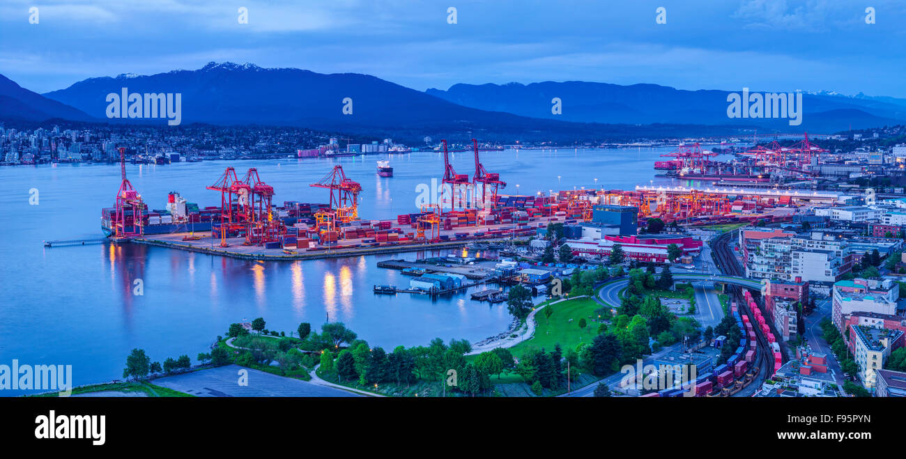Container cranes and loading docks. Crab park in foreground. - Stock Image