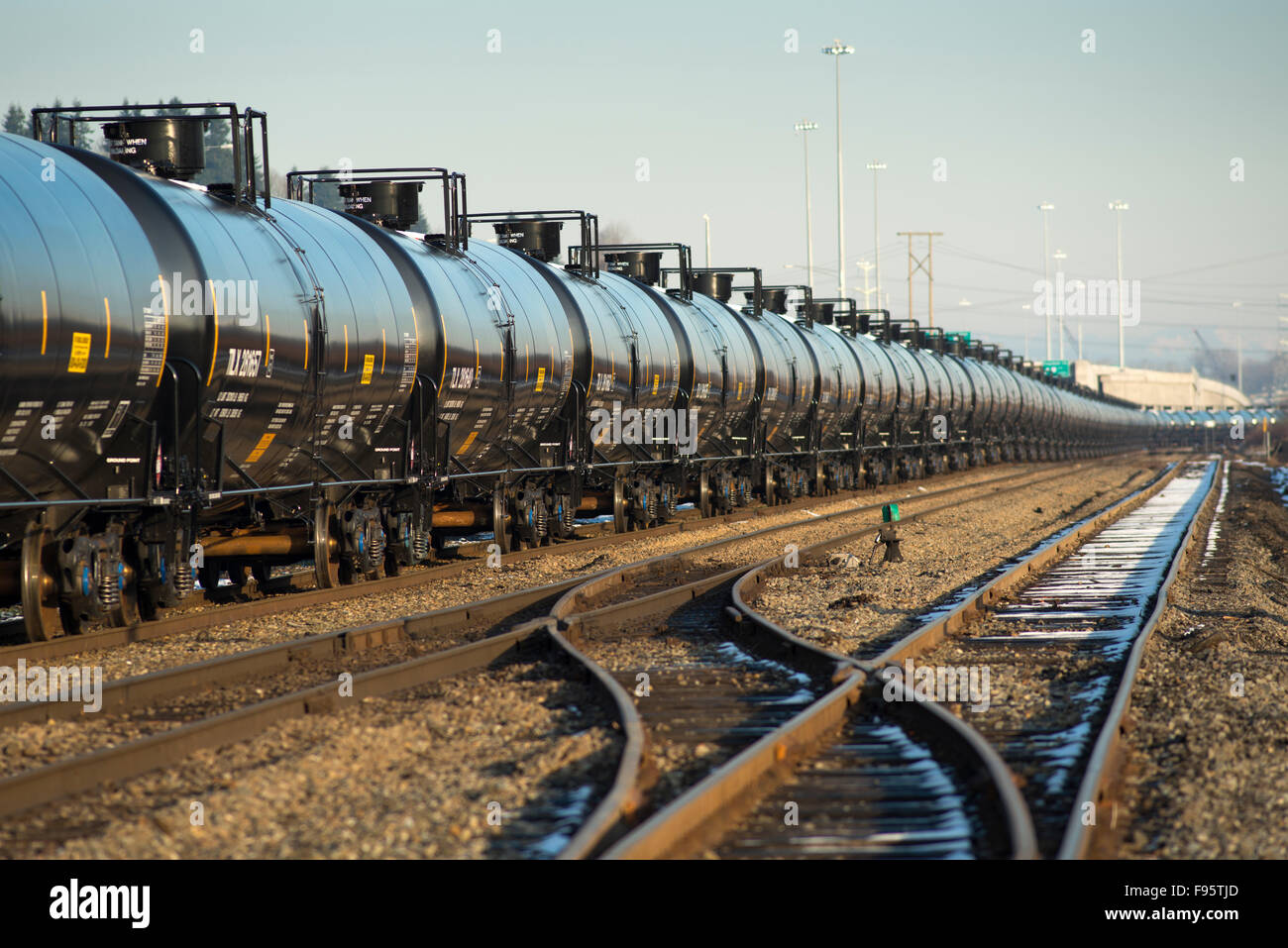 Crude oil rail cars sitting on tracks in Coquitlam, BC, Canada. - Stock Image