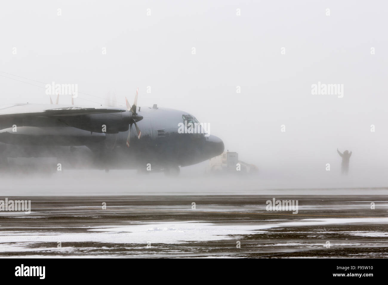A Royal Canadian Air Force Lockheed Hercules aircraft in a blizzard in Iqaluit, Nunavut, Canada Stock Photo