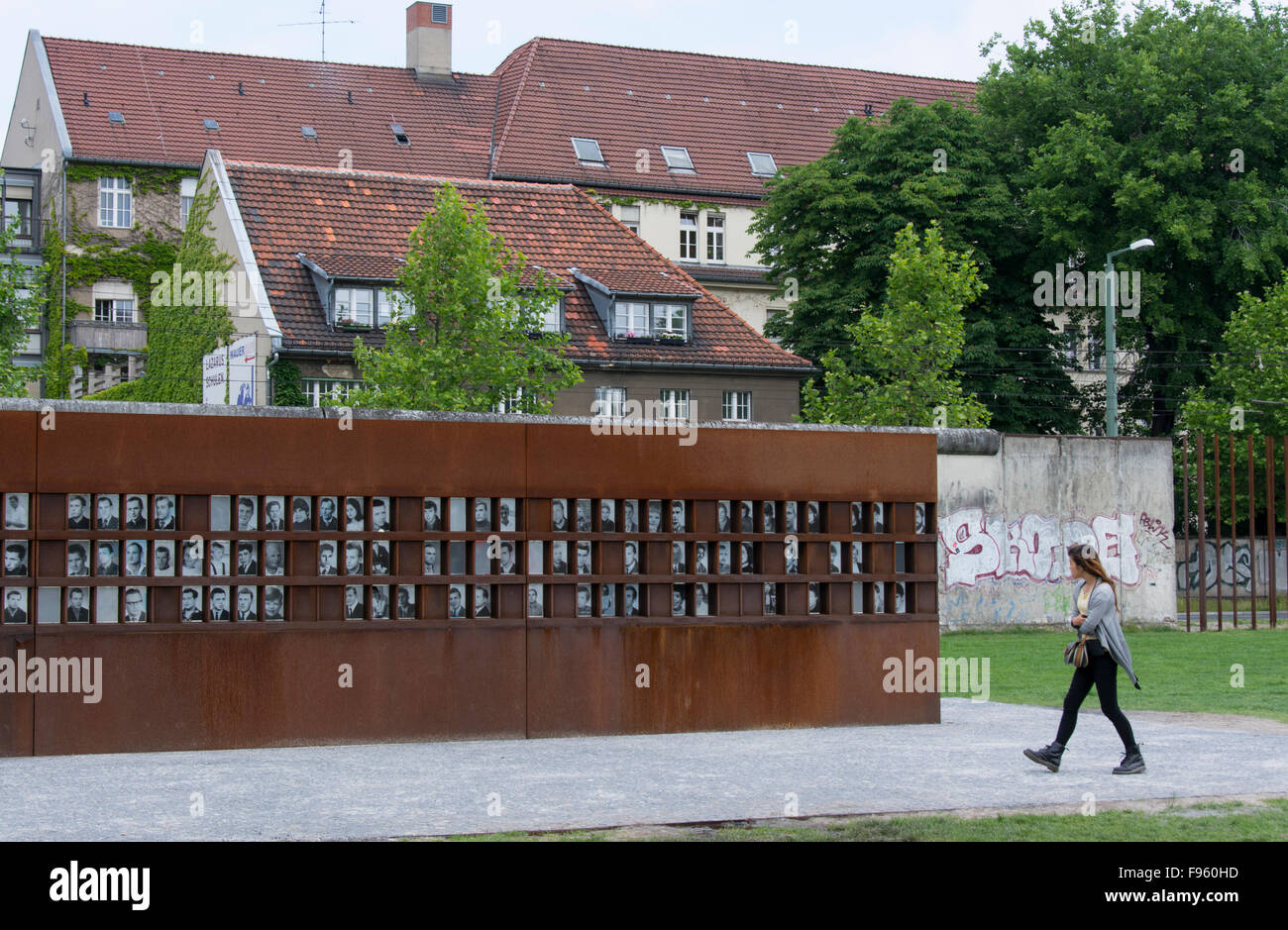 The Berlin Wall Memorial, with images of killed people, on Bernauer Strasse, Berlin, Germany - Stock Image