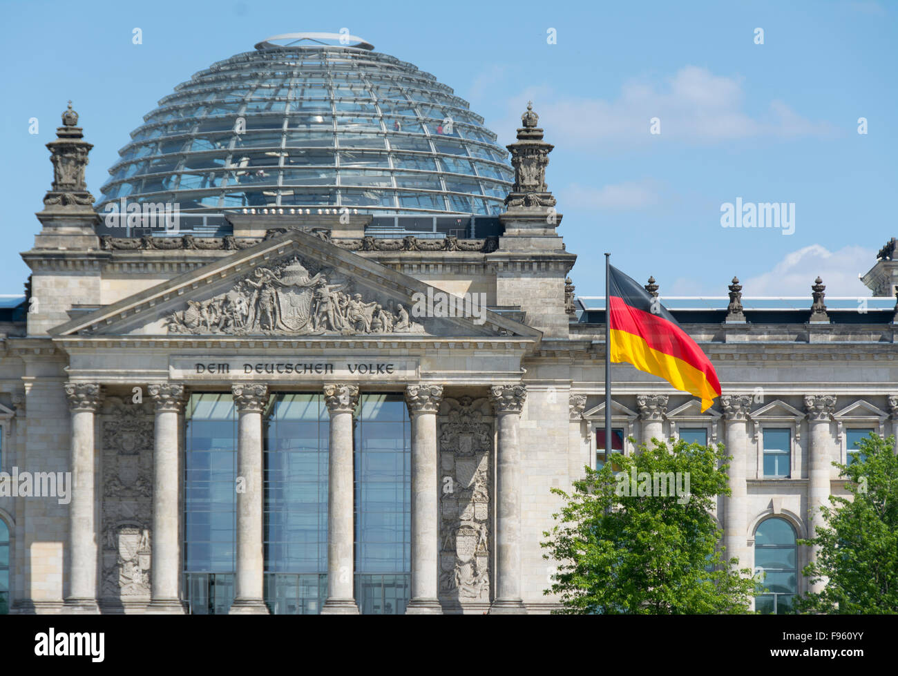German flag and the Reichstag building, a historical edifice in Berlin, Germany - Stock Image