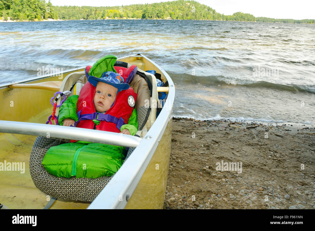A baby geared up for his first canoeing adventure, Killarney Provincial Park, Ontario - Stock Image