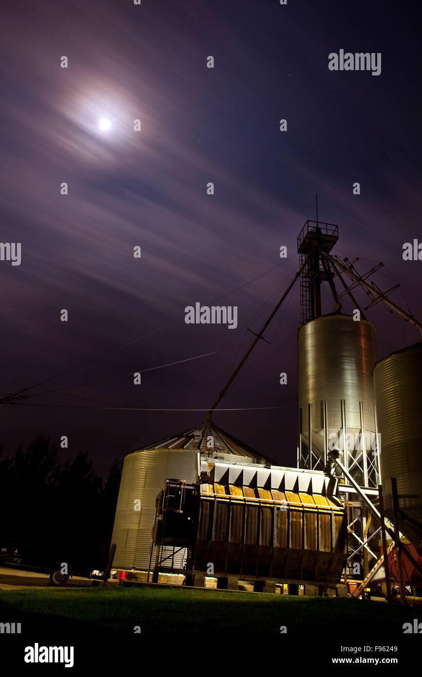 Grain mill at night. - Stock Image