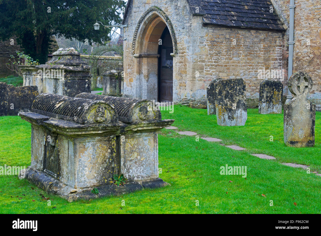 Churchyard of St Mary's Church, Bibury, Cotswolds, Gloucestershire, England UK - Stock Image