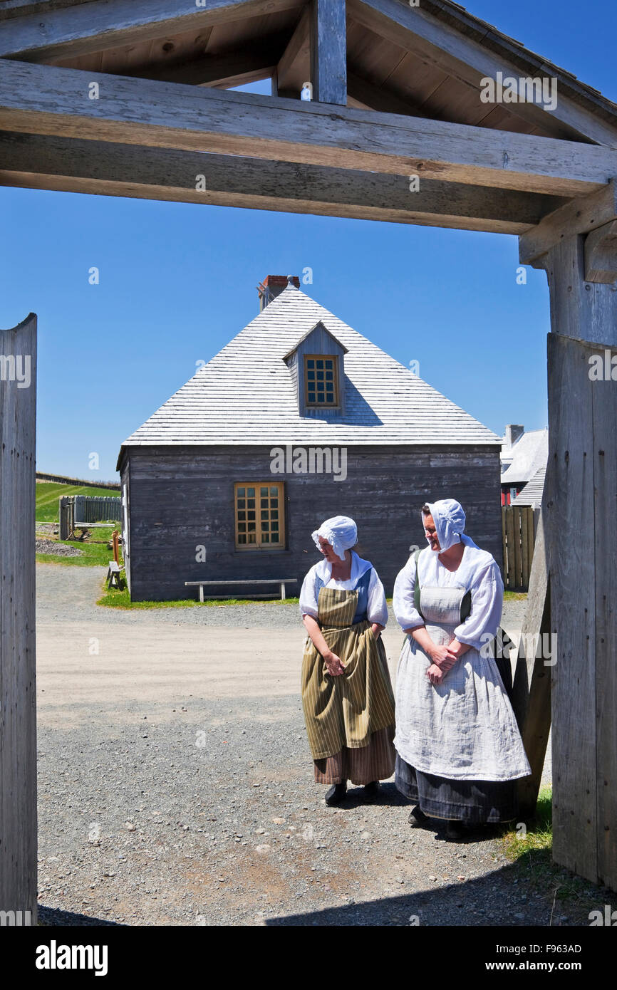 Two women in servants' costumes as part of the reenactment of daytoday life in 18th Century Fortress of Louisbourg. - Stock Image