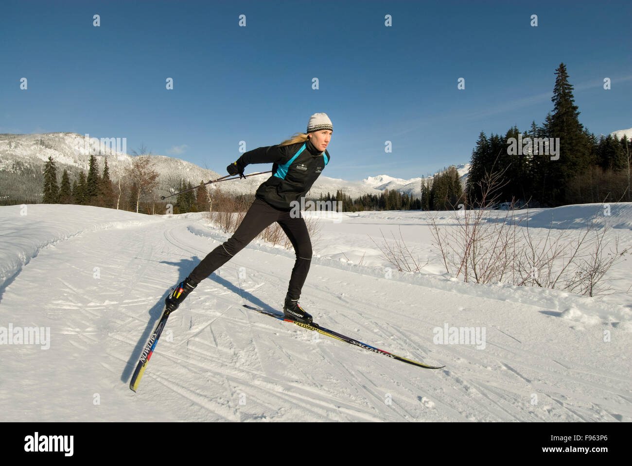 Cross country skier Maria Lundgren skates the trails at Green Lake, part of the Lost Lake trail system in Whistler, - Stock Image