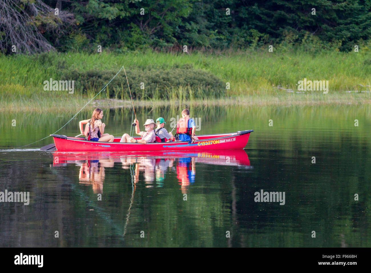 Family fishing on Crescent Lake in Lake Superior Provincial Park, Ontario, Canada - Stock Image