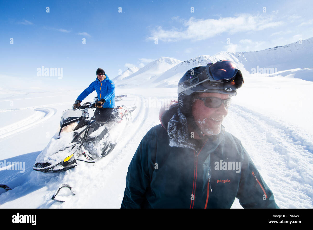Back country enthusiasts check out a fresh untracked field of dry powder while skiing in the Mckenzie Mountains - Stock Image