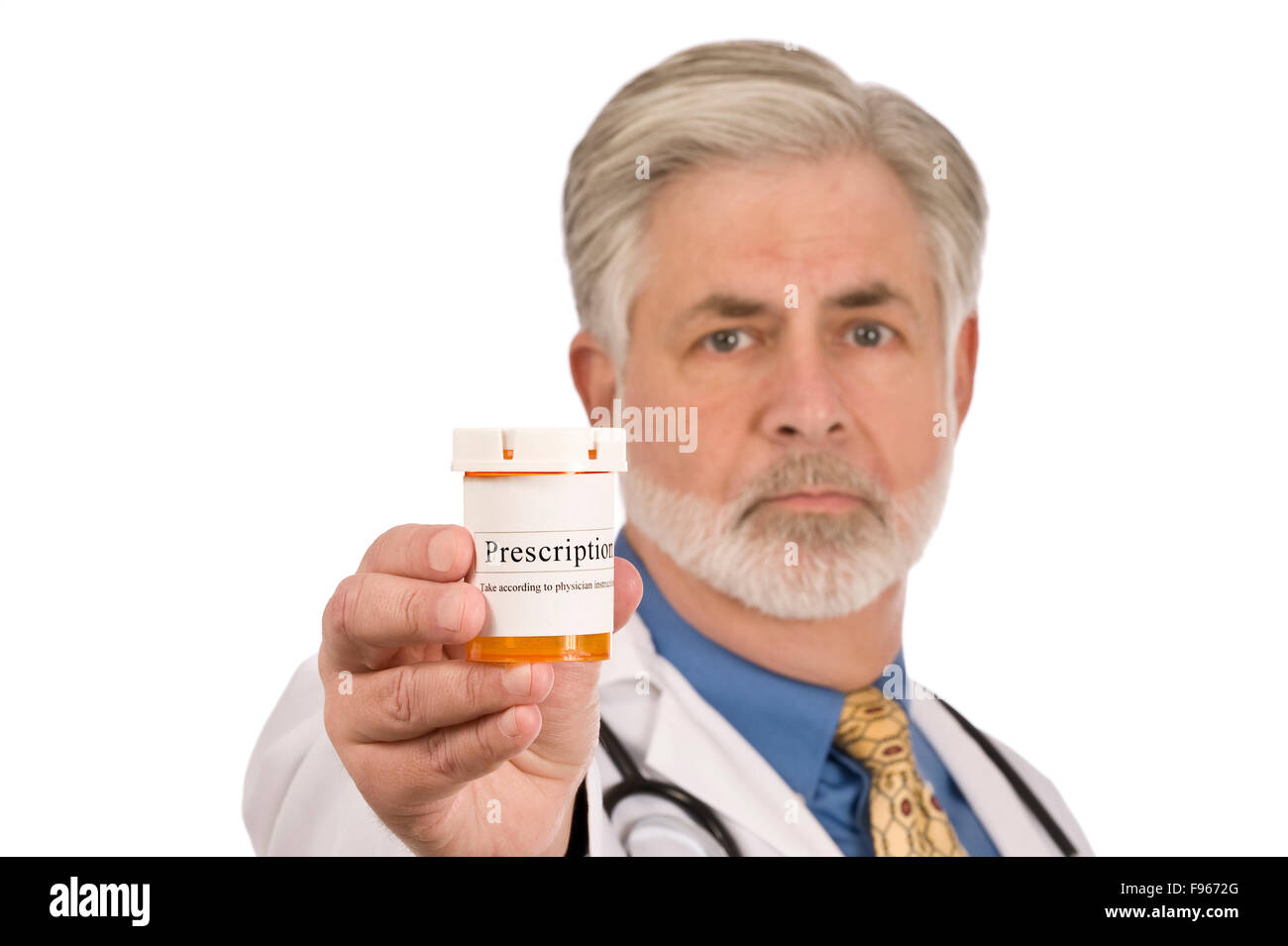 Male doctor holds out a prescription medication bottle - Stock Image
